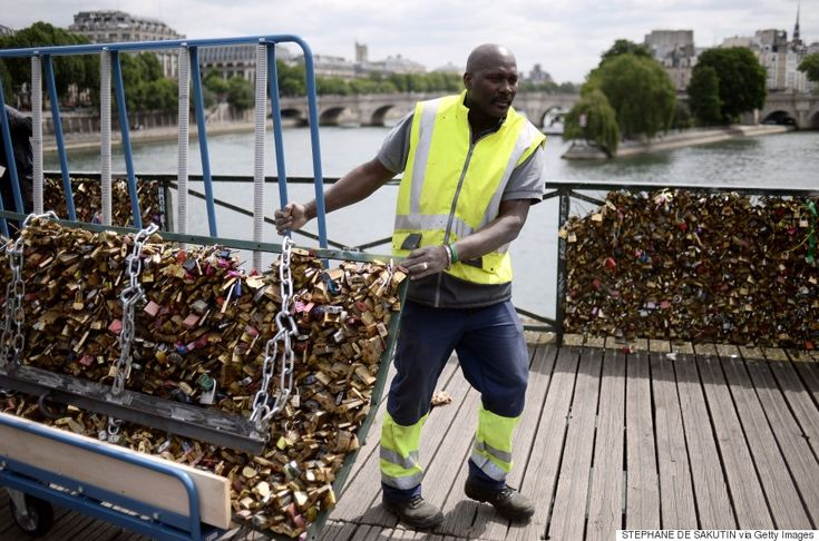 Paris Removes Love Locks From Famous Bridge: for me, it's a bit sad to see them go, even if the tradition only started in 2008. Wish they could find some way to use the locks (melted down) for some kind of memorial to it.