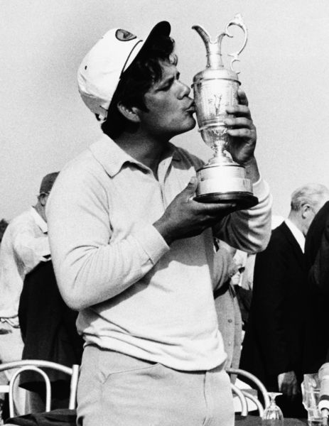 Original caption: Lee Trevino Kisses The Trophy After He Had Won The Championship. The Open Golf Championship at Muirfield, Scotland.