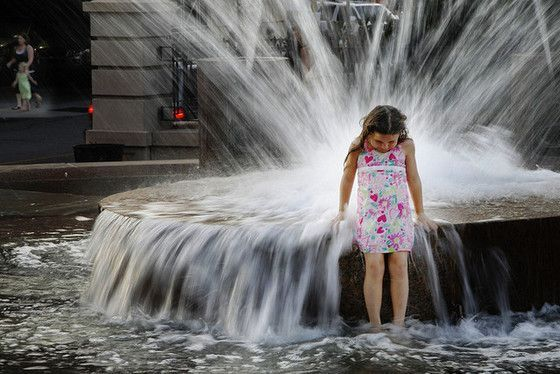 Slow Shutter Speed Photography Girl at the fountain
