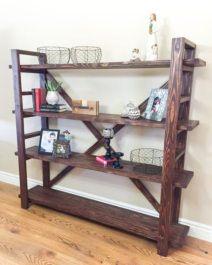 Learn how to build a DIY bookshelf inspired by Anthropologie with a few supplies from the hardware store. Free building plans by Jen Woodhouse.