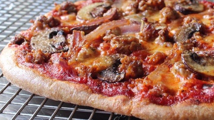 """Chef John's newest recipe for pizza dough calls for the """"ancient grain"""" spelt in sprouted flour form, and makes a delightful alternative to traditional pizza dough."""
