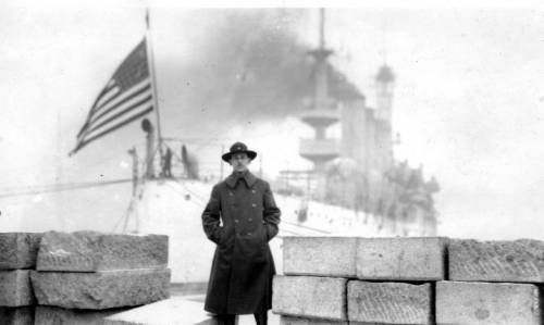 Mark Moody in front of the USS South Dakota. http://digitallibrary.usc.edu/cdm/ref/collection/p15799coll46/id/186