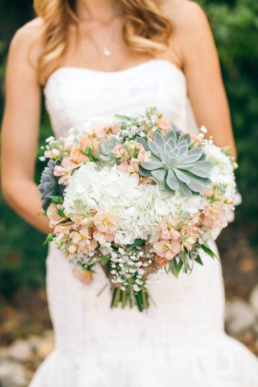 Her bridal bouquet was full of white hydrangea, peach stock, babies breath and a few succulents.