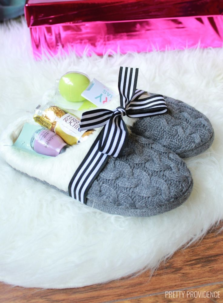 Fill a pair of cozy slippers with goodies, such as nail polish, candy, or lip balm. See more at Pretty Providence.