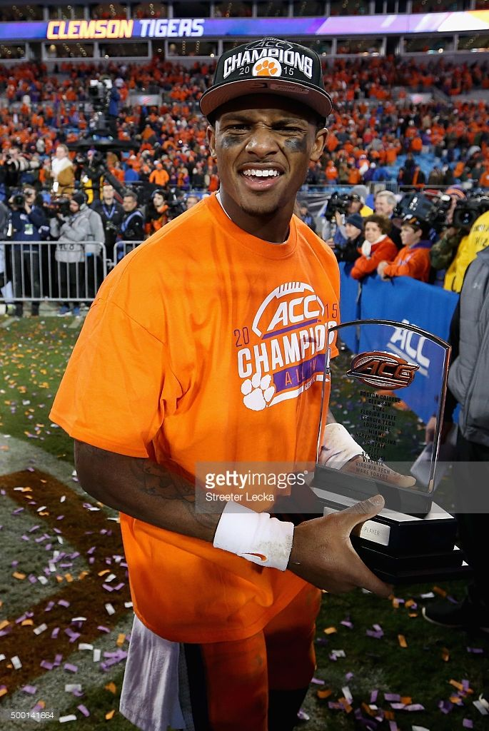 Deshaun Watson #4 of the Clemson Tigers celebrates as he holds the most valuable player trophy after defeating the North Carolina Tar Heels 45-37 at the Atlantic Coast Conference Football Championship at Bank of America Stadium on December 5, 2015 in Charlotte, North Carolina.