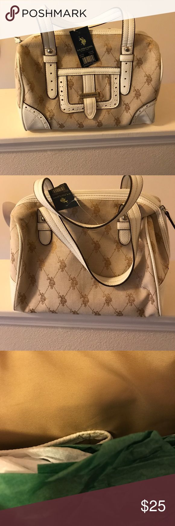 US Polo Assn handbag Aloha! This handbag is brand new & has the tags on it still.  I have not had the chance to use it.  It's kind of a beige color with off white. U.S. Polo Assn. Bags