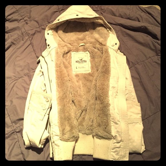 Hollister Coat White Holister coat with a SUPER SOFT inside lining. There is a slight discoloration on the inner part of a sleeve. Could probably be hidden with some TLC and bleach. Hollister Jackets & Coats Utility Jackets