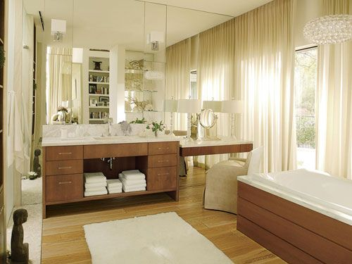 Having a mirror wall in your bathroom can be a great choice for both practical and style purposes. It gives you lots of space to get ready in front of (applying makeup, shaving, plucking, etc.) and it opens up the space. If the room doesn't have a lot of natural light, it also brightens up the bathroom by reflecting what light there is. Would you consider having a mirror wall in your bathroom?