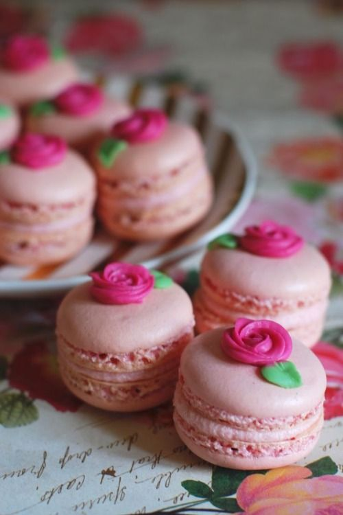 Macarons could be any flavor and have any filling, the flowers would be made with royal icing so they would keep their shape and not smear