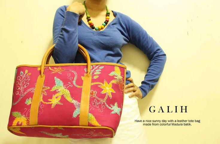 Galih Fuchsia handbag wrapped in Madura Batik & added with leather handle. Available at djokdjabatik.com