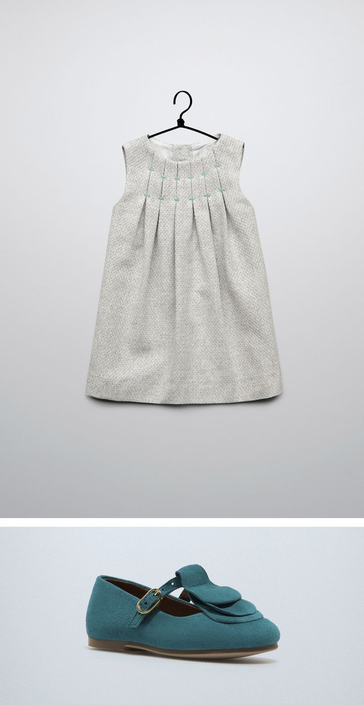 This would be nice for winter with black and white wool herringbone and neon stitching around the box pleats
