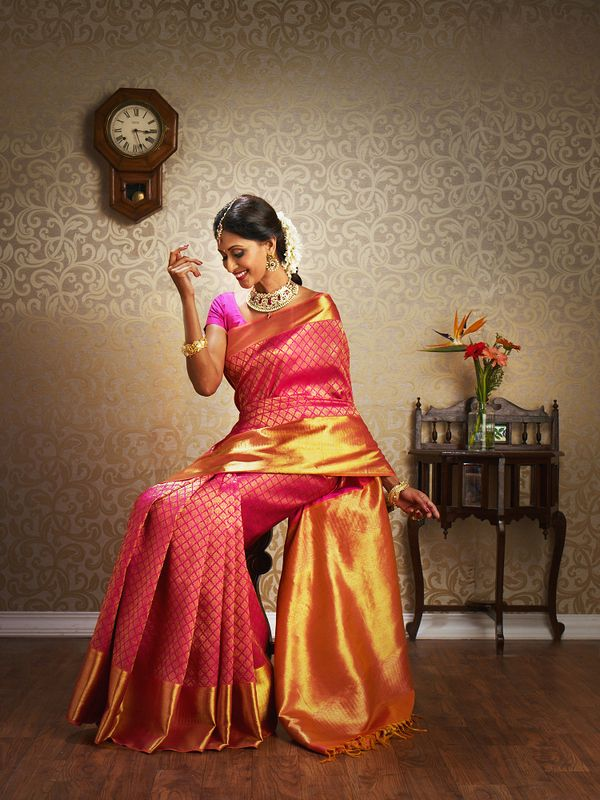 A Classy South Indian bride. Love that the border is so big! #indian #wedding #silksaree
