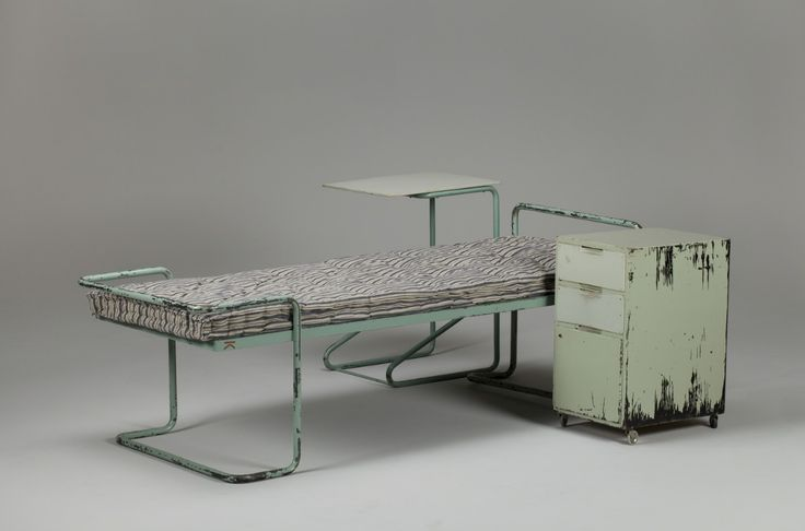 Alvar Aalto. It doesn't look all that nice does it but right now I'm imagining those tube frames in dazzling chrome. That rolling bedside table in pure white and a chunky new mattress just waitng to be made up. That would be very cool ;)