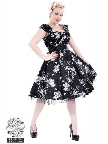 Black & White Floral Swing Dress by H&R London at Anomalie Clothing - http://anomalieclothing.com.au/products/black-white-floral-swing-dress-hearts-and-roses - Features gorgeous white floral pattern on a black background; sweetheart neckline; capped sleeves; detachable black satin ribbon belt; knee length full swing skirt; lining to the skirt with a layer of netting peeking out from behind the hem. Can be worn with or without a petticoat (Petticoat not included). Vintage Spring 1950s 1960s