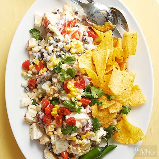 If an extraordinary potato salad recipe is what you're seeking, this Mex-ed up version topped with tortilla chips will knock your socks off. Chipotle-infused dressing adds heat to every savory bite; celery and corn bring the crunch./