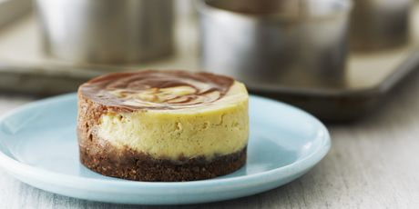 Individual Chocolate Swirl Cheesecakes - Courtesy of Anna Olson - Bake With Anna Olson - These individual desserts are filled with a creamy, mascarpone filling and only the crust needs to be baked in the oven. The crust bakes into a crunchy, cookie-like crust. For a more traditional crust, you can use a graham cracker crust recipe, as in a New York Cheesecake.
