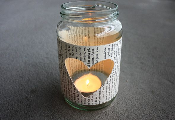 DIY Glass Jar Tea Light Holder    Reuse your jars!!!    Supplies: Two book pages from an old book, a glass jar, a scalpel, a pair of scissors, a glue stick and a tea light. 1. I started with cutting a heart out from one of the pages using the scalpel. Then I cut the page making it fit the jar.