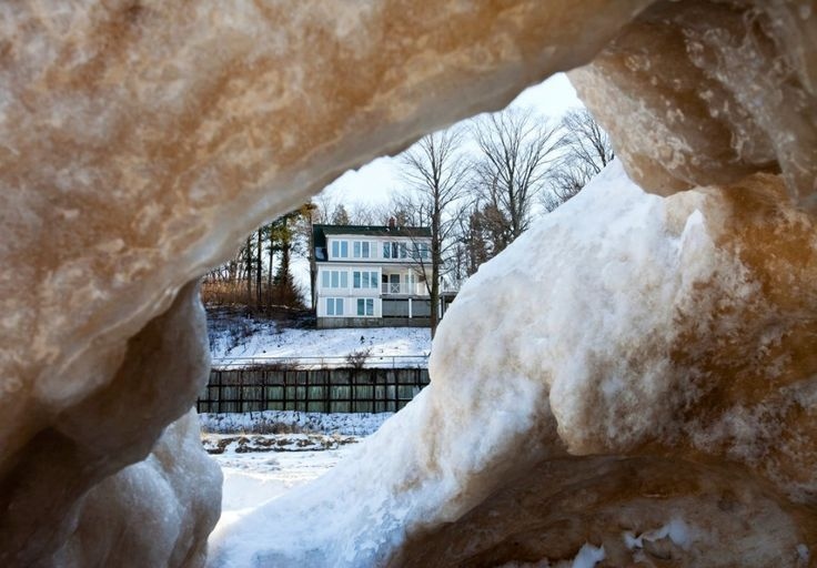 A lunar landscape awaits at Lake Michigan where winter ice caves have formed! #mittenlove