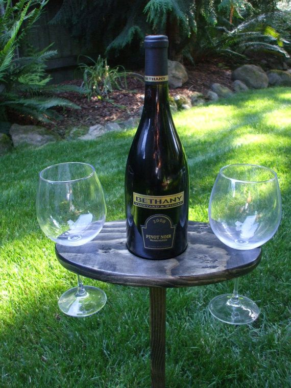 Portable Outdoor Wine Table And Glass Holder - Wine Glasses Included. $25.00, via Etsy.