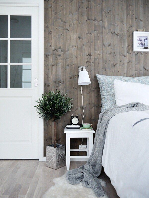 The interesting wall paneling really makes this room and the soft brown brings just the right amount of warmth to the room's cool color palette.