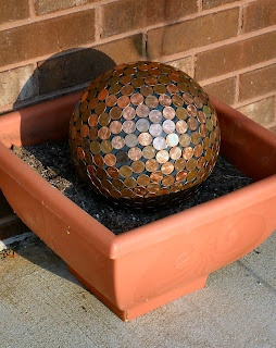 Copper kills slugs where as salt only dehydrates them, but they continue to live....Penny Ball for the garden. Pennies in the garden repel slugs and make hydrangeas blue. I love this idea. It looks old and new and beautiful.