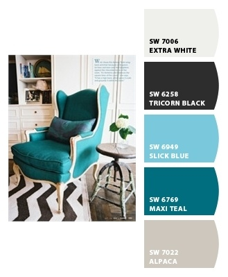 Great for livingroom! Black accents with dark stained and distressed woods, turquiose slip cover on recliner, soft blue throws on sofa, cream colored walls with ornate detailing. Deer head. Nice rug and throw blankets