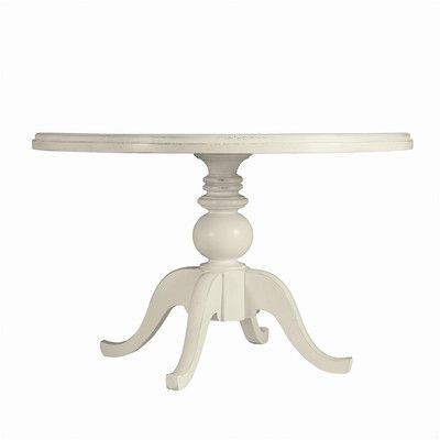 A round dining table in white is a classic piece. | $1,719