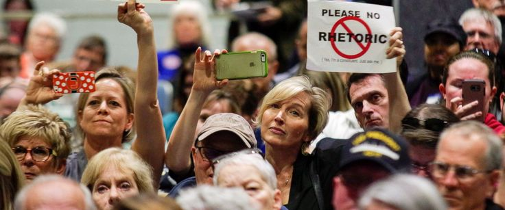 PHOTO: Constituents of Virginias 2nd District hold up signs during a town hall meeting held by U.S. Representative Scott Taylor (R-VA) at Kempsville High School in Virginia Beach, Virginia, Feb. 20, 2017.
