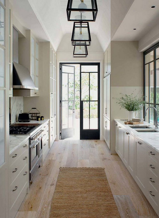white kitchen, love the lanterns and French doors