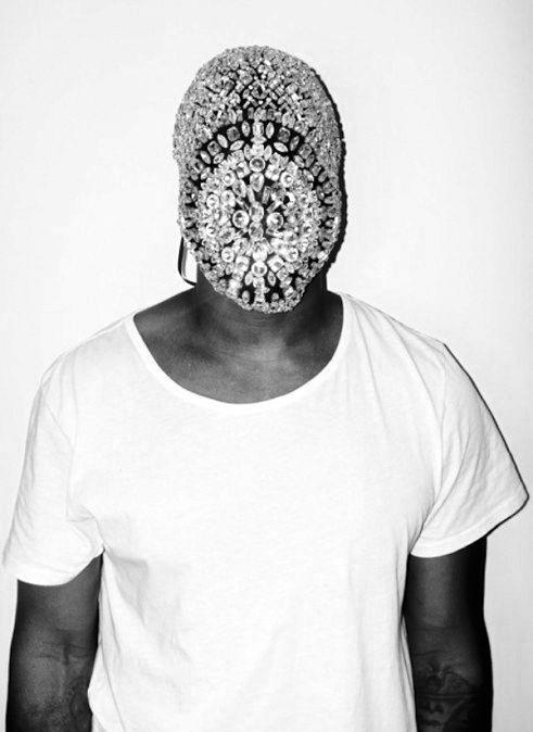 Kanye West in Fear of God Los Angeles 'Basic White Tee' and Maison Martin Margiela mask.