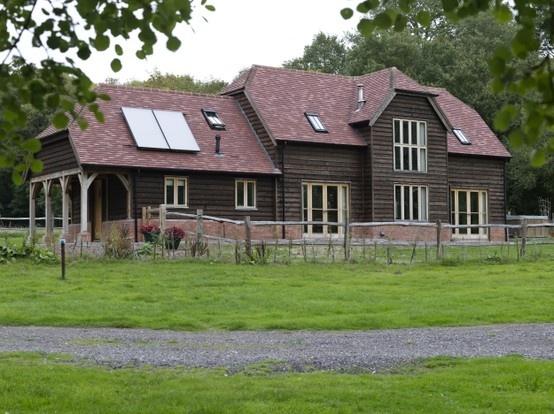 A Border Oak Barn with dark weatherboarding.