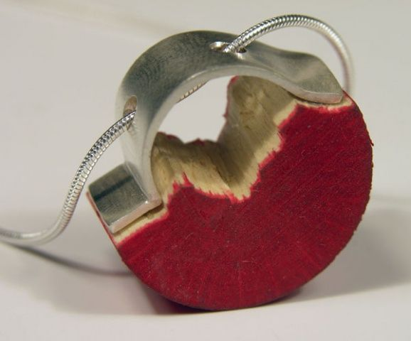 "Teresa F. Faris Collaboration With a Bird  2008  wood chew toy, Sterling Silver  .75"" x .75"" x .5""  pendant:"