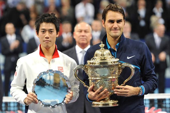 Roger Federer and Kei Nishikori Photos Photos - Kei Nishikori of Japan and Roger Federer of Switzerland pose with their trophies after the final on day seven of the Swiss Indoors at St Jakobshalle on November 6, 2011 in Basel, Switzerland. - Swiss Indoors Basel - Day Seven