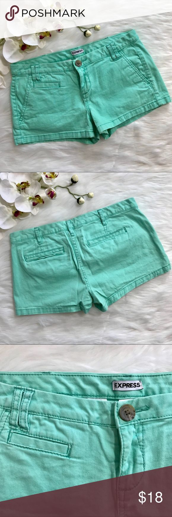 "EXPRESS MINT GREEN SHORTS - SIZE 2 Cute minty green chino shorts. Excellent condition - Worn only one time! Back pockets are real/working, but still tacked closed from the manufacturer. Approx. 15.5"" at waist, 1.75"" inseam, and 7.5"" rise. Stock photo included to show style. Please review other photos for actual item being sold. Express Shorts Jean Shorts"