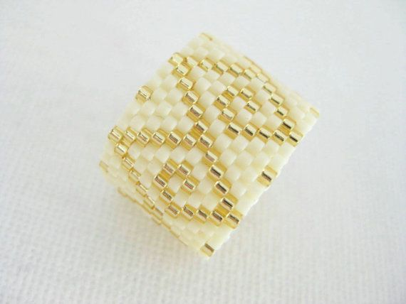 A beautiful, peyote ring! Made of Japanese delica beads in cream and silver lined gold.    This beadwoven ring is very comfortable to wear and