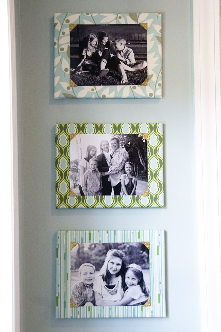 LOVE this idea, mount pictures on canvas' covered with fabric