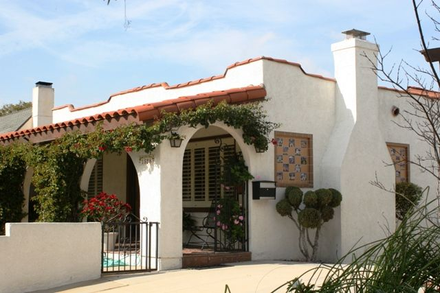 Spanish Mission House Wrought Iron Low Pitched Roof Arcaded Porch With Adjoining Arches