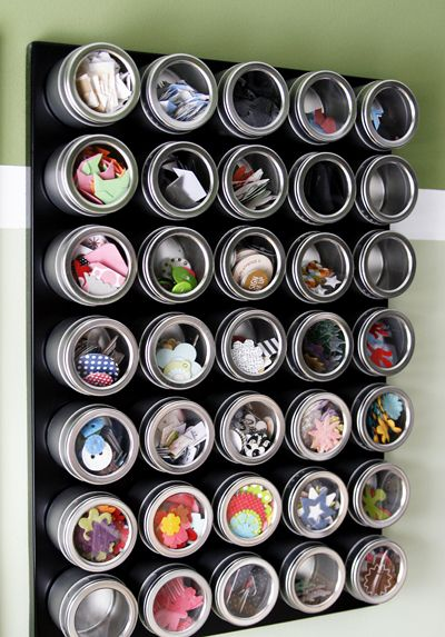 Organization in the craft room using magnetic board and tins. Great idea!