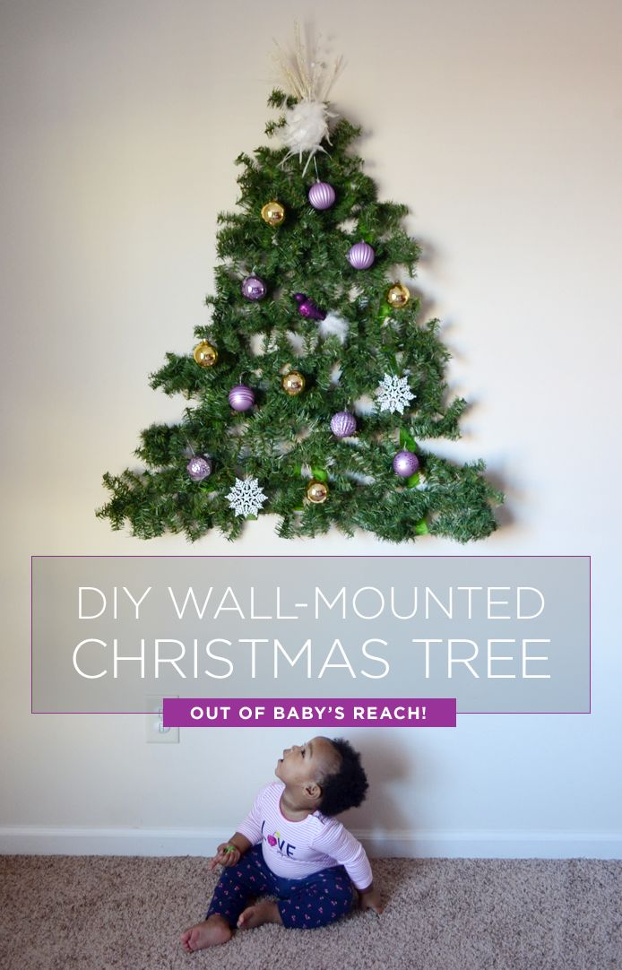 Have a baby or toddler? Make a DIY tree you can mount on the wall out of their reach using supplies from Walmart! #wmtmoms #christmasdecor #christmastree
