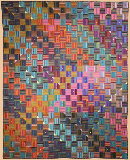 those little triangles change the whole thing... brilliant quilter Kent Williams - At Cross Purposes