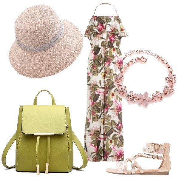 Una jumpsuit che lascia scoperte le spalle, in una deliziosa fantasia floreale, viene proposta con dei sandali rosa, allacciati con dei cinturini alla caviglia. Lo zainetto richiama il color verde militare di alcuni elementi della fantasia della jumpsuit, mentre il braccialetto con fiorellini è rosa. Il cappello panama dona un pizzico di eleganza al tutto.