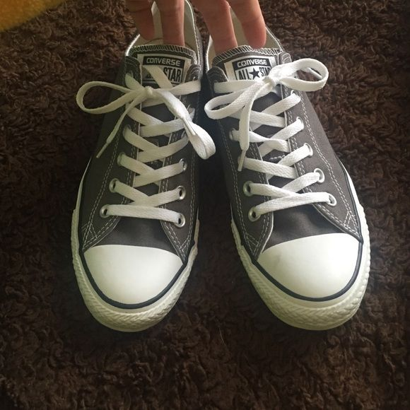 Gray converse Never worn. They do have a one scuffs but I dont know how it got there. And the backs (see picture) have a little darkness to them. Other than that they look so new and perfect. Converse Shoes