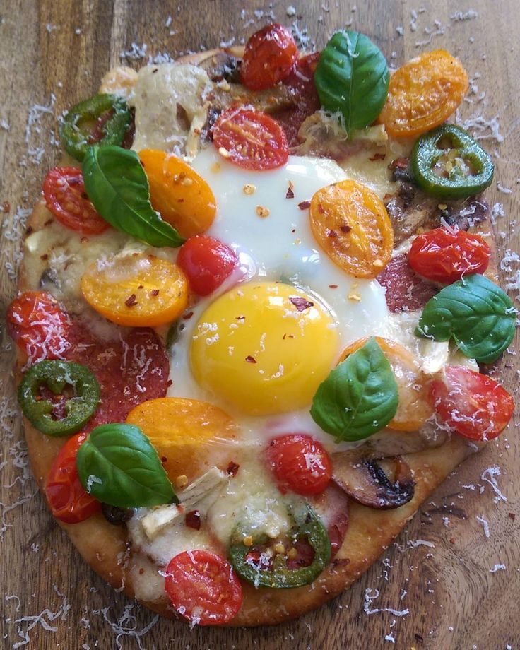 Lunch is served!  OMG was it tasty! Naan, brushed with olive oil, topped with mushrooms, salami, jalapenos, tomatoes, parmesan, brie, an egg, red pepper flakes, fresh basil and more parmesan.@zimmysnook