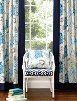 Lantern Garden from Warwick Fabrics.  What do you think of the band on the drapes?  Love the chair and cushion.