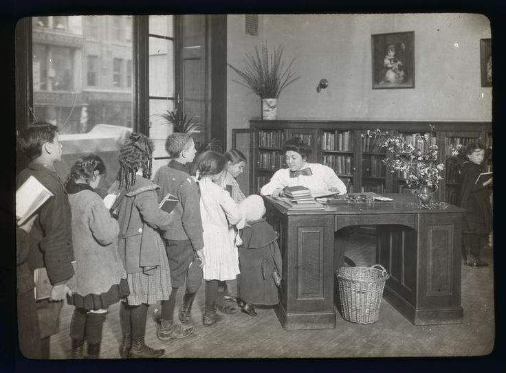 Children lined up at the Chatham Square Branch librarian's desk, 1910. From 25 Vintage Photos of Librarians Being Awesome.