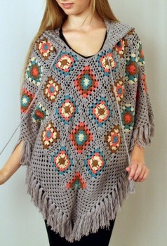 Crochet pancho lined with fringe, functioning drawstring and a hood. $46.99