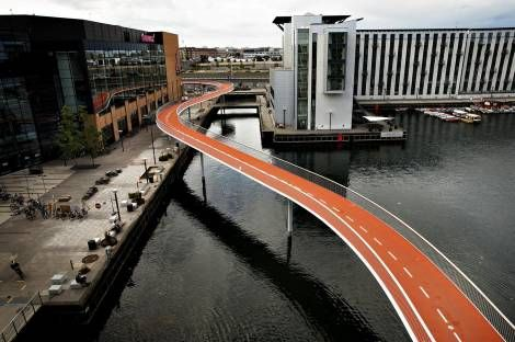 """""""The Bicycle Snake (Cykelslangen) is Copenhagen's newest addition to create the world's best city for cyclists by 2015"""" text via http://www.stateofgreen.com/en/Newsroom/Copenhagen%E2%80%99s-New-Bicycle-Bridge"""
