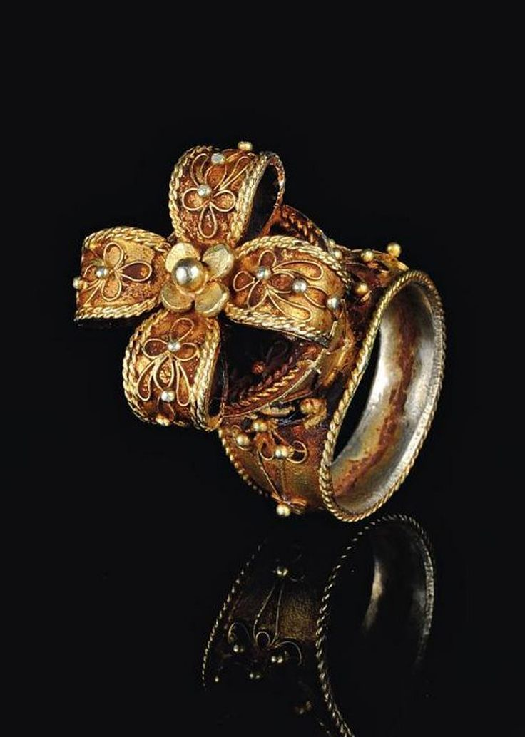 Indonesia ~ Sumatra | Batak Karo flower crown-shaped man's ring; gold alloy | Page 74, 'Ethnic Jewellery from Indonesia. Continuity and Evolution' By Bruce W. Carpenter