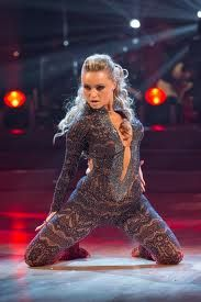 Black Lace Catsuit with Plunge Neckline worn By Ola Jordan. Click Here To Buy your Catsuits from DCUK.