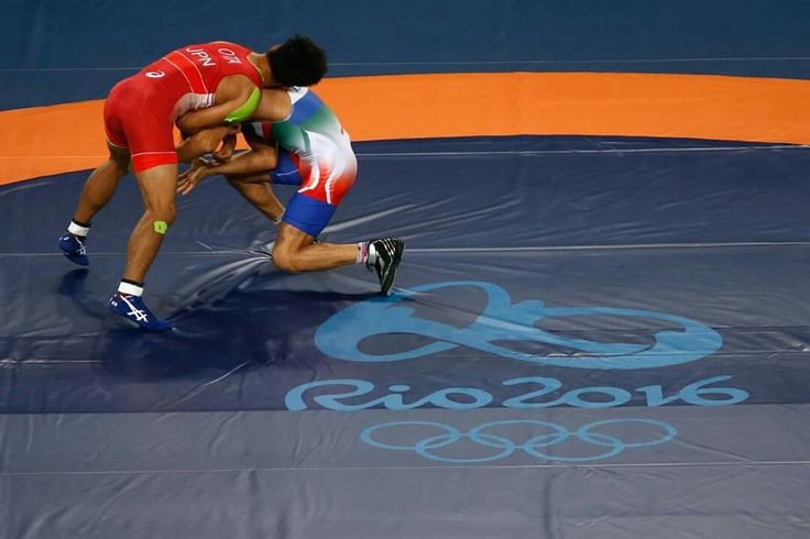 RIO DE JANEIRO, BRAZIL - AUGUST 14: Shinobu Ota of Japan (red) competes against Hamid Mohammad Soryan of Iran during the Men's 59 kg Greco-Roman Wrestling qualifications on Day 9 of the Rio 2016 Olympic Games at the Carioca Arena 2 on August 15, 2016 in Rio de Janeiro, Brazil. (Photo by Phil Walter/Getty Images) — in Rio de Janeiro, Brazil.
